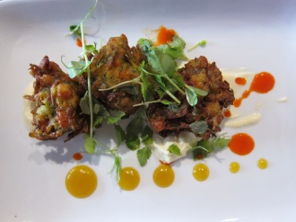 Zucchini fritters with orange gel and sour cream $12